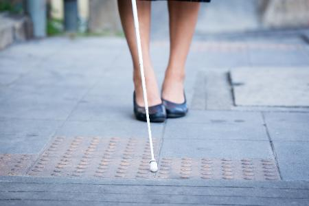 Image of a women with white cane