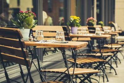 Table and chairs outside a restaurant